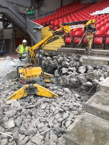 Controlled demolition of concrete terracing at Liverpool FC